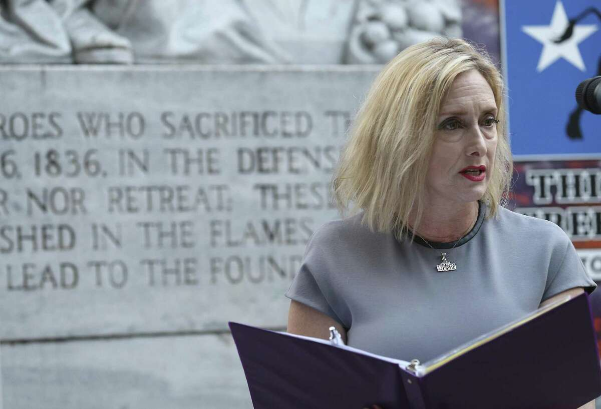 Liz Case Pickens, a descendant of Alamo defender William Barret Travis, speaks at the This Is Texas Freedom Force remembrance rally on Friday at the Cenotaph.