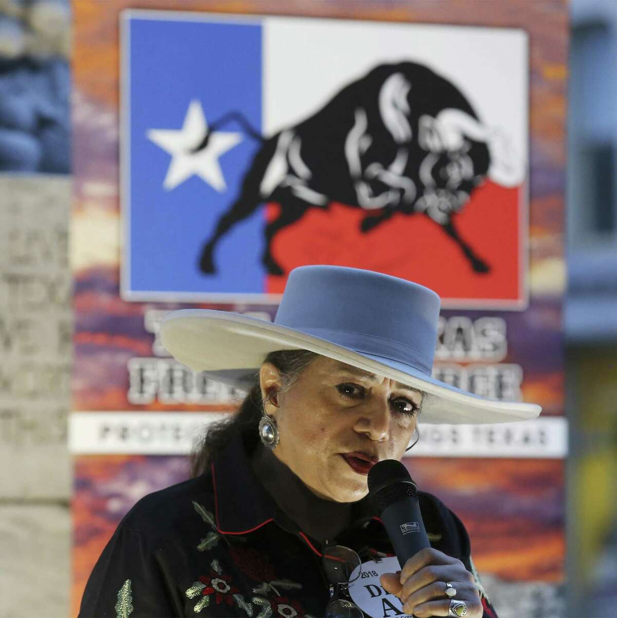 Dr. Alma Arredondo-Lynch, who is running for Congress, District 23, speaks at the This Is Texas Freedom Force's Remember The Alamo remembrance rally Friday at the Cenotaph.