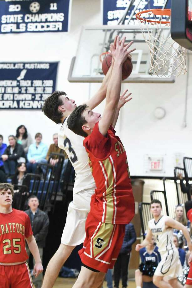 Stratford's Joseph August, right, and Immaculate's Jack Woods during the Stratford at Immaculate SWC boys basketball quarterfinal in Danbury, Feb. 23, 2018. Photo: Krista Benson / The News-Times Freelance