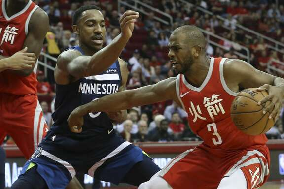 Houston Rockets guard Chris Paul (3) is defensed by Minnesota Timberwolves guard Jeff Teague (0) during the second quarter of the NBA game at Toyota Center on Friday, Feb. 23, 2018, in Houston. ( Yi-Chin Lee / Houston Chronicle )