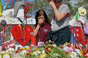 Marjory Stoneman Douglas High School administrative employees grieve after last week's deadly shooting at the school in Parkland, Fla. In Texas, Gov. Greg Abbott has called for a review of school safety procedures in the wake of the Parkland massacre.