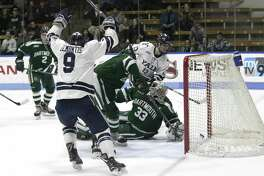 Yale's Robbie DeMontis (9) celebrates a goal by the Bulldogs during Friday's game against Dartmouth.