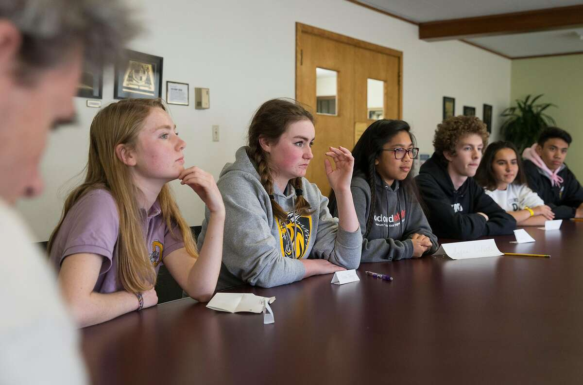 (From left) Bishop O'Dowd High School junior Alden O'Rafferty, 16, junior Olivia Talley, 16, junior Sofia Odeste, 17, junior Eli McAmis, 16, freshman Paulina Harding, 14, and freshman Aleki Lozano, 14, speak about their thoughts and feelings in the wake of the recent Parkland, Florida high school shooting Thursday, Feb. 22, 2018 in Oakland, Calif.