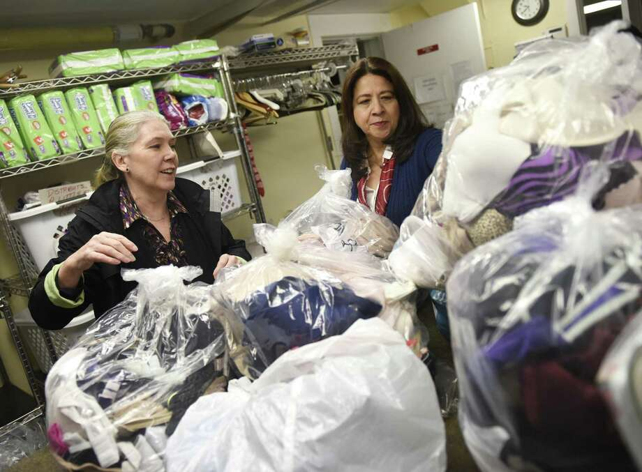 Undies Project co-Presidents Lucy Langley, left, and Laura Delaflor sort this year's Mardi Bra donations at Neighbor to Neighbor in Greenwich, Conn. Thursday, Feb. 22, 2018. Photo: Tyler Sizemore / Hearst Connecticut Media / Greenwich Time