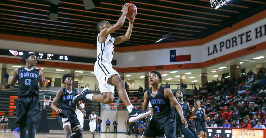 February 23, 2018:  PA Memorial Jamyus Jones (2) leaps for the layup during the 5A  Area Playoff Boys basketball game between the Port Arthur Memorial Titans and Shadow Creek Sharks at La Porte High School in La Porte, Texas. (Leslie Plaza Johnson/Freelance Photo: Leslie Plaza Johnson/For The Chronicle