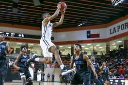 February 23, 2018:  PA Memorial Jamyus Jones (2) leaps for the layup during the 5A  Area Playoff Boys basketball game between the Port Arthur Memorial Titans and Shadow Creek Sharks at La Porte High School in La Porte, Texas. (Leslie Plaza Johnson/Freelance