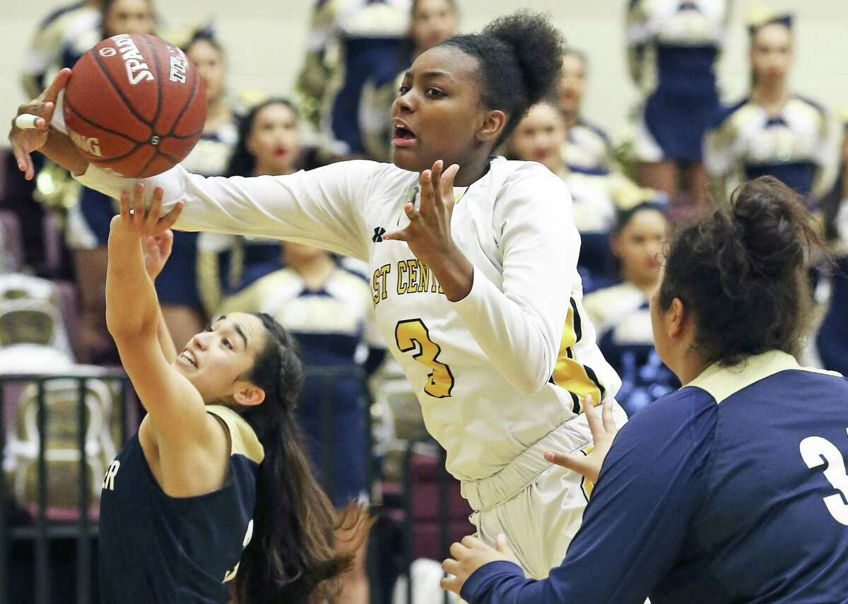 Hornet's forward Nalyssa Smith grabs a rebound between Valerie Lopez (left) and Yulianna Zamora as East Central plays Laredo Alexander in the Region IV-6A semifinals at Littleton Gym on February 23, 2018.
