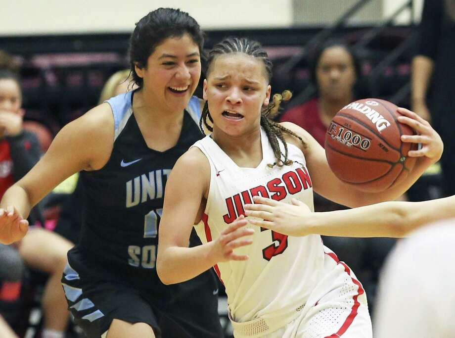 Rocket guard Corina Carter moves the ball into the paint against Katherine Soto as Judson plays United South in the Region IV-6A semifinals at Littleton Gym on February 23, 2018. Photo: Tom Reel, Staff / San Antonio Express-News / 2017 SAN ANTONIO EXPRESS-NEWS
