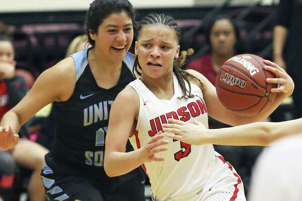 Rocket guard Corina Carter moves the ball into the paint against Katherine Soto as Judson plays United South in the Region IV-6A semifinals at Littleton Gym on February 23, 2018.