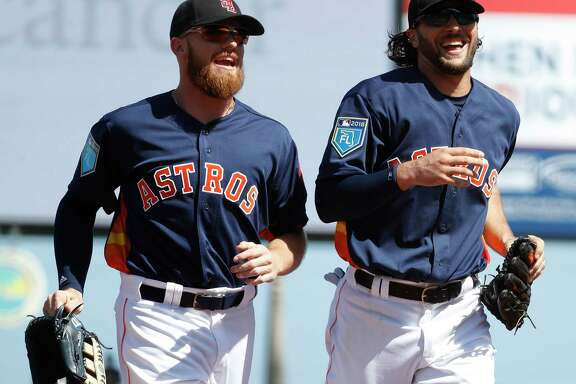 Derek Fisher, left, and Jake Marisnick trot to the dugout after Marisnick made a diving catch to end the Nationals' first inning Friday. The Astros went on to beat the Nationals 3-2 in the exhibition opener at Fitteam Ballpark of the Palm Beaches.