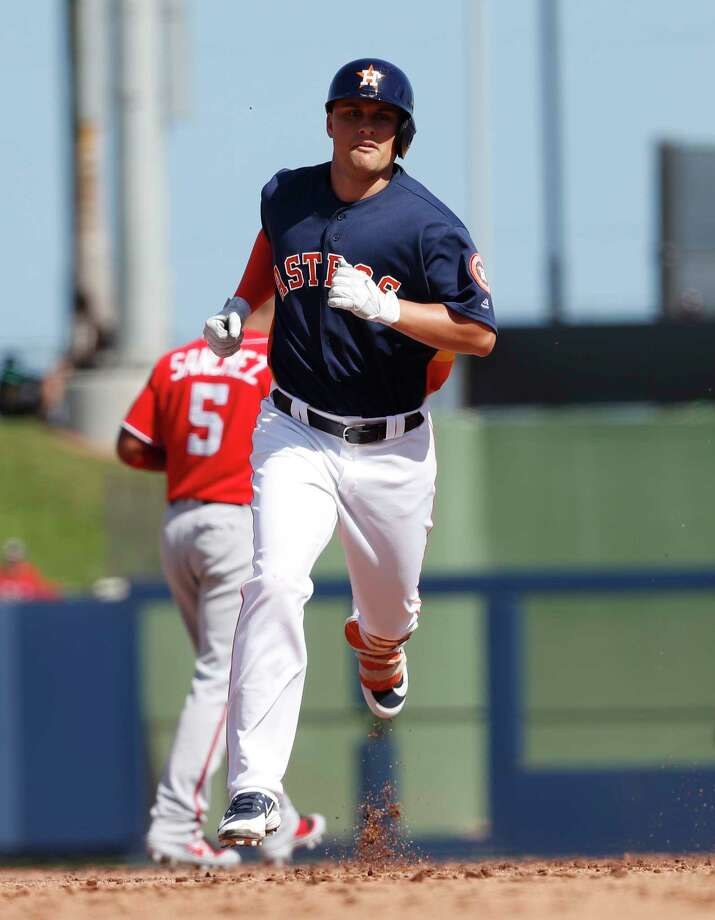 J.D. Davis rounds the bases after slugging a home run this spring. The Astros' prospective first baseman got to use his home-run trot twice on Friday against the Twins. Photo: Karen Warren, Staff / © 2018 Houston Chronicle