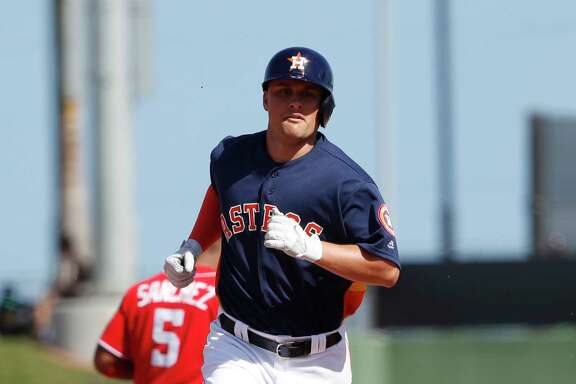J.D. Davis rounds the bases after slugging a home run this spring. The Astros' prospective first baseman got to use his home-run trot twice on Friday against the Twins.