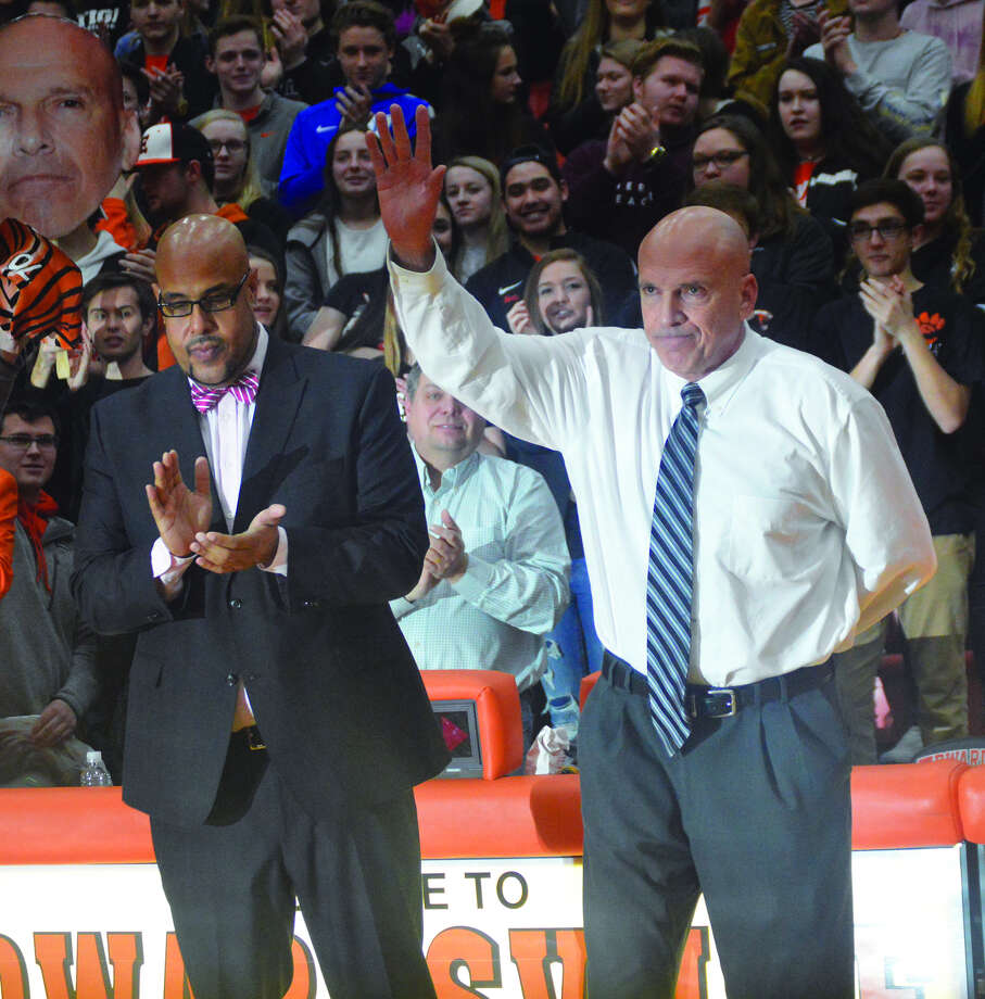 Edwardsville boys' basketball coach Mike Waldo, right, acknowledges the crowd during a pregame ceremony before Friday's game against Belleville East. It was Waldo's final home game. EHS athletic director Alex Fox is to the left.