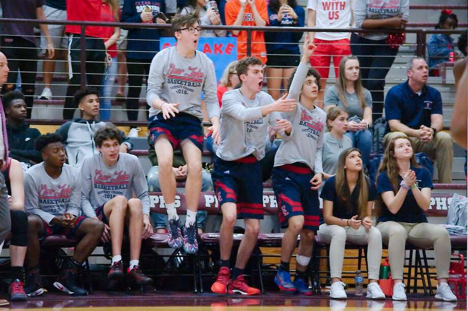 Clear Lake fans react to a call on the court against North Shore Friday, Feb. 23 at Pearland High School. Photo: Kirk Sides / Houston Chronicle