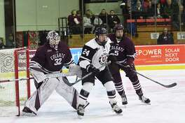 Liam Morgan of Union positions himself between Paul McAvoy, right, and goalie Colton Point during their game on Friday, Feb. 23, 2018, at Messa Rink. (Dave Kibbe / Colgate Athletics)