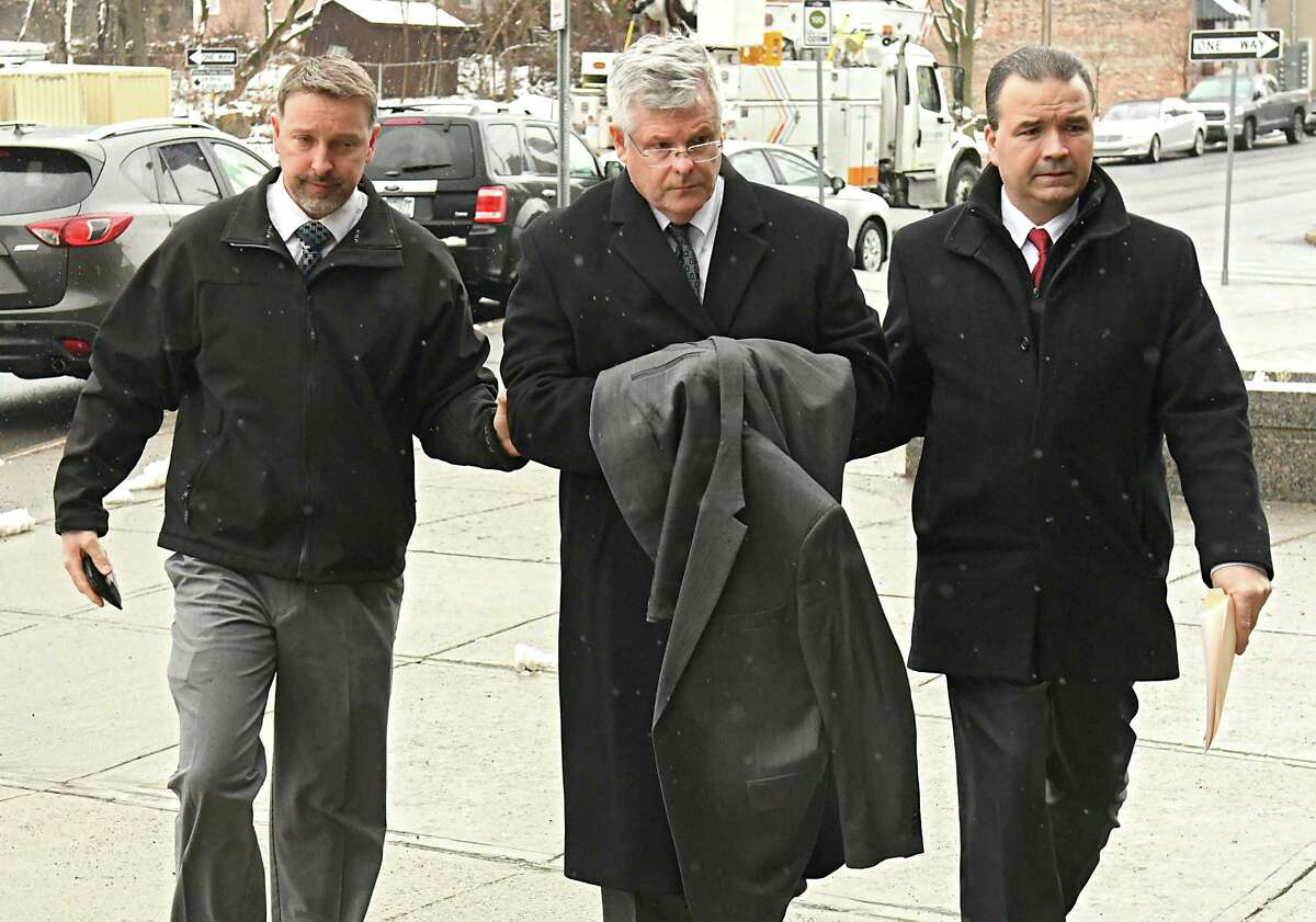 Richard J. Sherwood, town justice in Guilderland, is brought into City Court by police officers after being arrested on Friday, Feb. 23, 2018 in Albany, N.Y. (Lori Van Buren/Times Union)