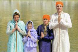 Canadian Prime Minister Justin Trudeau (R)along with his wife Sophie Gregoire Trudeau (L)daughter Ella-Grace (2nd L) and son Xavier (2R) pay respect at the Sikh Shrine Golden temple  in Amritsar on February 21,2018. Trudeau and his family are on a week-long official trip to India. / AFP PHOTO / NARINDER NANUNARINDER NANU/AFP/Getty Images