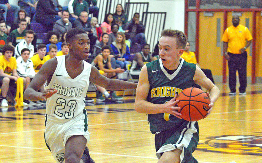 Metro-East Lutheran junior Jonah Wilson, right, drives past a Madison defender during Friday's championship game at the Class 1A Mount Olive Regional.