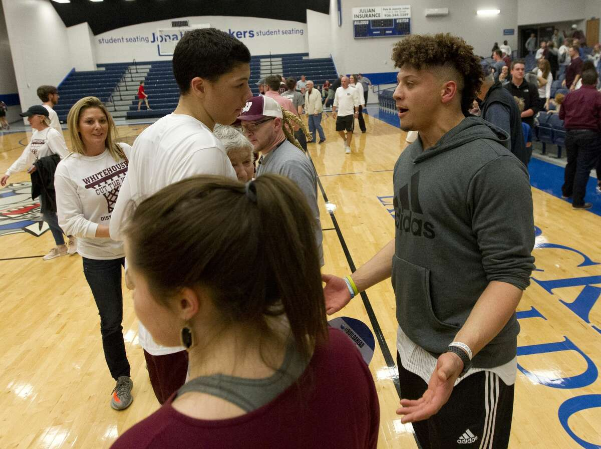 Kansas City Chiefs quarterback Patrick Mahomes II talks with his brother Jackson after Whitehouse defeated Magnolia 49-44 in a Region III-5A high school area playoff game at Crockett High School, Friday, Feb. 23, 2018, in Crockett.