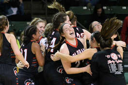 Colorado girls basketball players react to a win against Idalou during the Region 1-3A girls basketball semifinal game Feb. 23, 2018, at Chaparral Center.  James Durbin/Reporter-Telegram