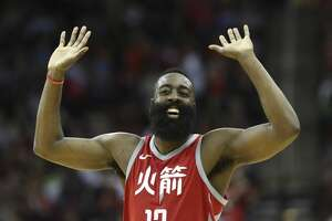 Houston Rockets guard James Harden (13) pumps his hands in the air to cheer for Houston Rockets guard Chris Paul fooling Minnesota Timberwolves forward Nemanja Bjelica and scoring two points during the fourth quarter of the NBA game at Toyota Center on Friday, Feb. 23, 2018, in Houston. The Houston Rockets defeated the Minnesota Timberwolves 120-102. ( Yi-Chin Lee / Houston Chronicle )