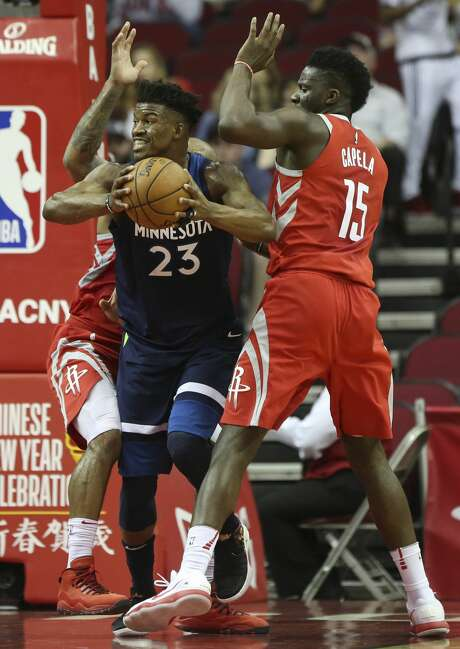 Minnesota Timberwolves guard Jimmy Butler (23) is covered by Houston Rockets players PJ Tucker (4) and Houston Rockets center Clint Capela (15) during the first quarter of the NBA game at Toyota Center on Friday, Feb. 23, 2018, in Houston. ( Yi-Chin Lee / Houston Chronicle ) Photo: YCL/Houston Chronicle