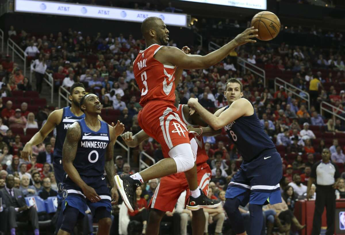 Houston Rockets guard Chris Paul (3) passes the ball during the second quarter of the NBA game against the Minnesota Timberwolves at Toyota Center on Friday, Feb. 23, 2018, in Houston. ( Yi-Chin Lee / Houston Chronicle )