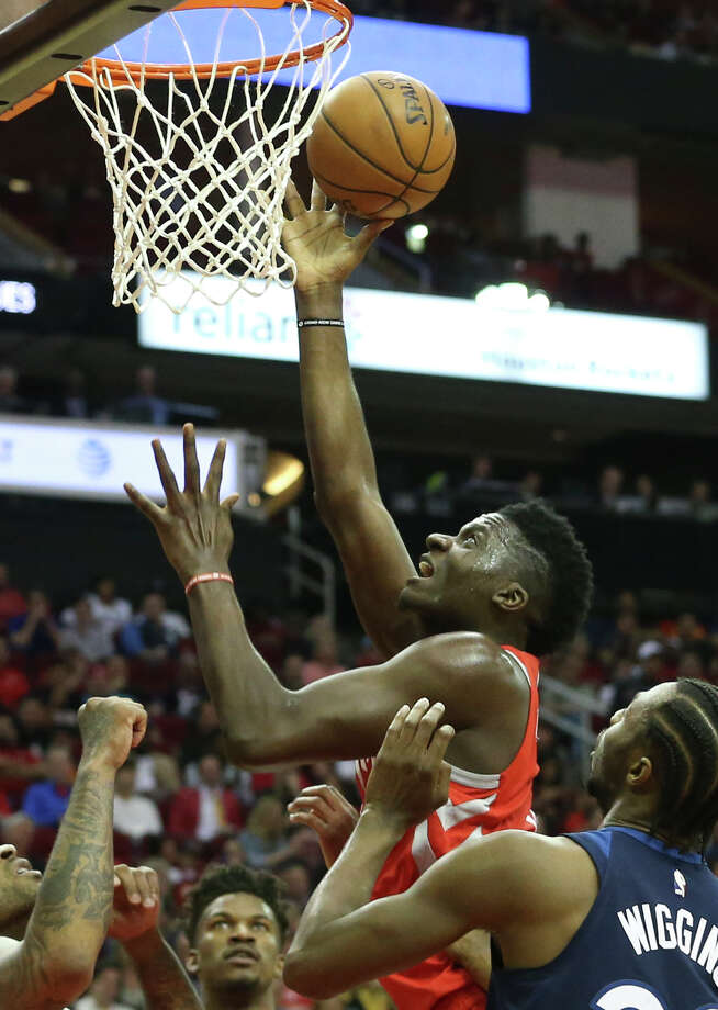 Clint Capela towers above the Timberwolves for two of his 25 points as the Rockets gradually pulled away for their 11th consecutive win Friday night. Photo: YCL, Staff / © 2018 Houston Chronicle