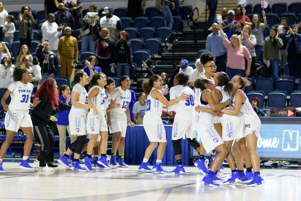 The Temple Wildcats girls basketball team celebrates after defeating the Barbers Hill Eagles in a girls Region III 5A Semi-Final Championship basketball game on Friday, February 23, 2018 at Delmar Field House in Houston Texas.