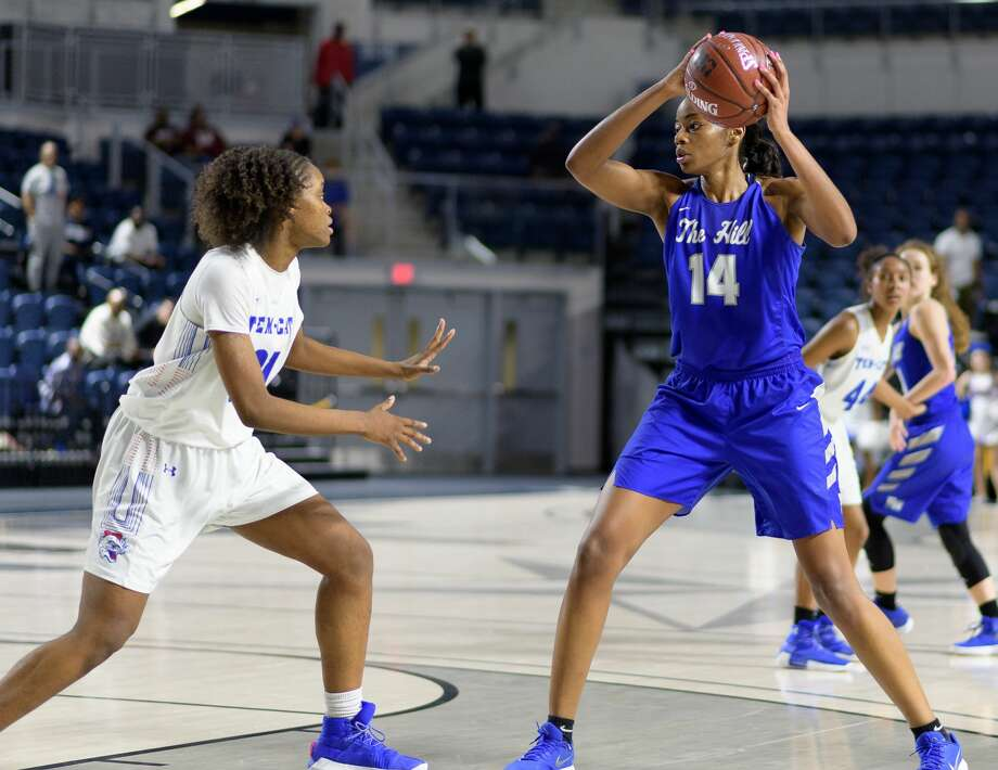 Charli Collier (14) of the Barbers Hill Eagles looks to pass the ball against the Temple Wildcats in a girls Region III 5A Semi-Final Championship basketball game on Friday, February 23, 2018 at Delmar Field House in Houston Texas. Photo: Wilf Thorne/For The Chronicle
