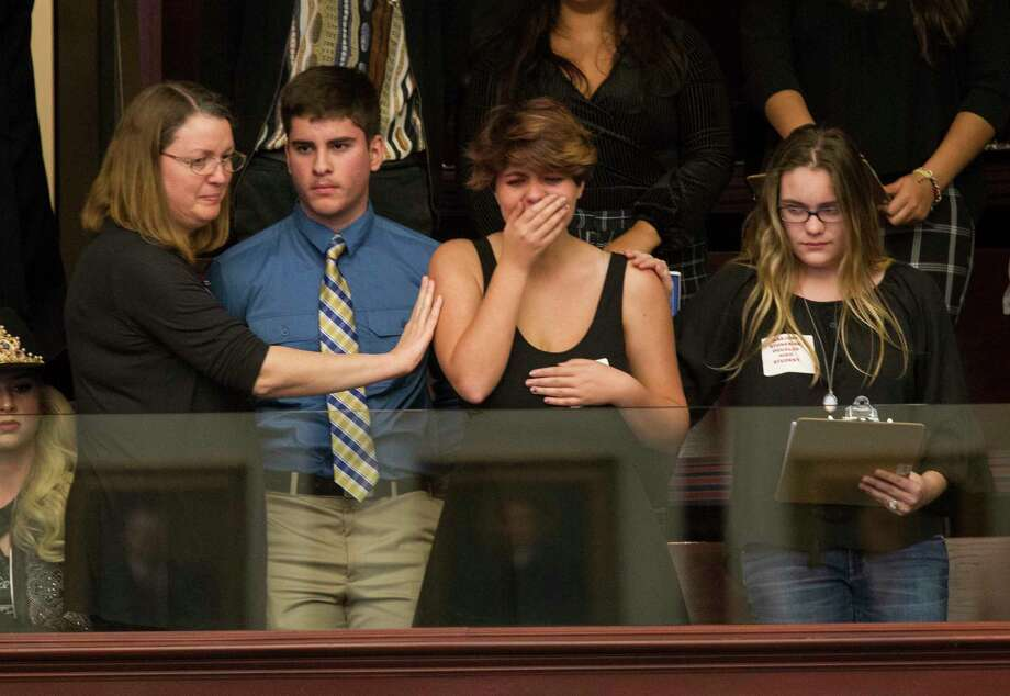 Sheryl Acquarola, a 16 year-old junior who survived the school shooting at Parkland, Fla., is overcome with emotion at the Florida Capitol after lawmakers voted not to hear a bill banning assault rifles. (AP Photo/Mark Wallheiser) Photo: Mark Wallheiser, FRE / FR171224 AP