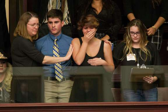 Sheryl Acquarola, a 16 year-old junior who survived the school shooting at Parkland, Fla., is overcome with emotion at the Florida Capitol after lawmakers voted not to hear a bill banning assault rifles. (AP Photo/Mark Wallheiser)