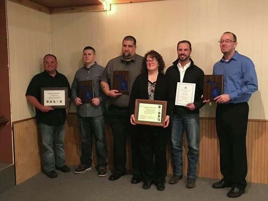 Recognized at the 21st Law Enforcement Appreciation dinner were, from left: Animal Control Officer Jim Maveal, Deputy Josh Maniez, Corrections Officer Vic Kraus, Crime Stoppers member Christie VanTiem, EMT Jim Primeau and 911 Dispatcher Chuck Peters. (Photo provided)