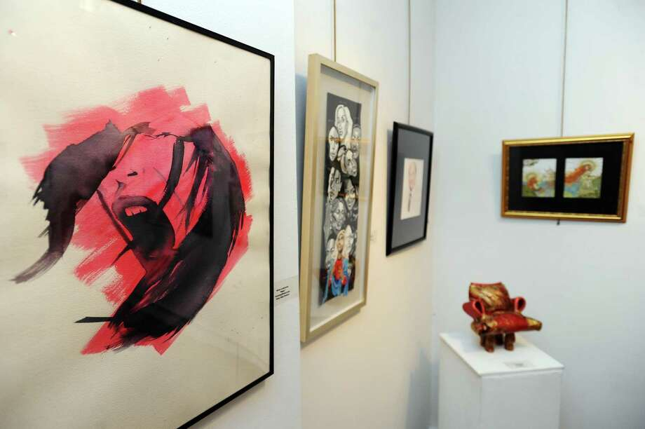 "King High School student Greer Lammens' ""Rage"" (left) during the 45th annual Stamford Art Associations student art show inside the Stamford Art Association Townhouse on Franklin Street in downtown Stamford, Conn. on Thursday, Feb. 22, 2018. Photo: Michael Cummo / Hearst Connecticut Media / Stamford Advocate"