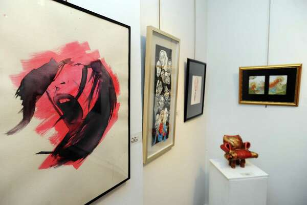 """King High School student Greer Lammens' """"Rage"""" (left) during the 45th annual Stamford Art Associations student art show inside the Stamford Art Association Townhouse on Franklin Street in downtown Stamford, Conn. on Thursday, Feb. 22, 2018."""