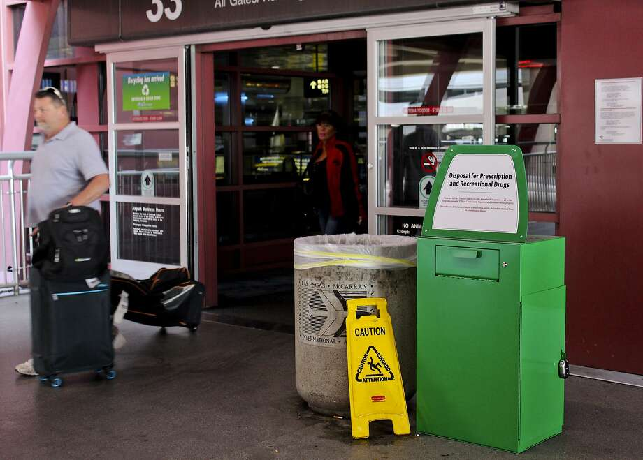 "Passengers at McCarran International Airport in Las Vegas may now use green ""amnesty boxes"" to dispose of any marijuana they might have on them before boarding their flights. Photo: Regina Garcia Cano, Associated Press"