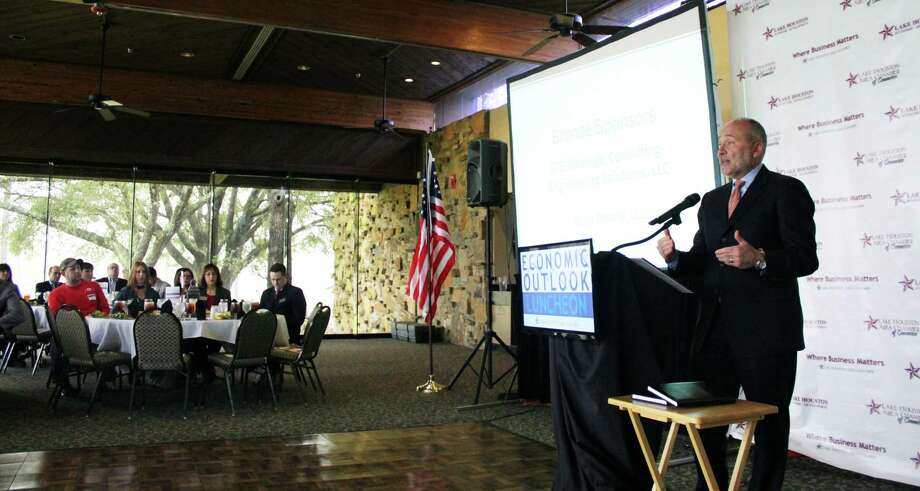 Thomas Melendez, investment officer and institutional equity portfolio manager, explains how the global market is doing at the Lake Houston Area Chamber of Commerce Economic Luncheon, Photo: Kaila Contreras