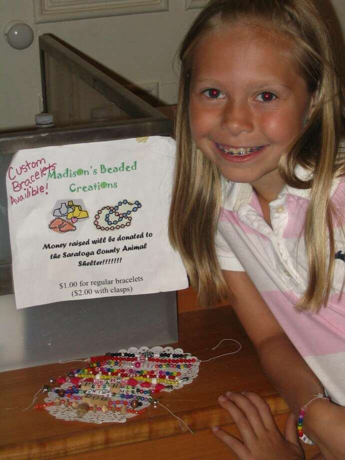 Madison Dallas, 9, made beaded bracelets to sell to raise funds for the proposed new Saratoga County Animal Shelter.
