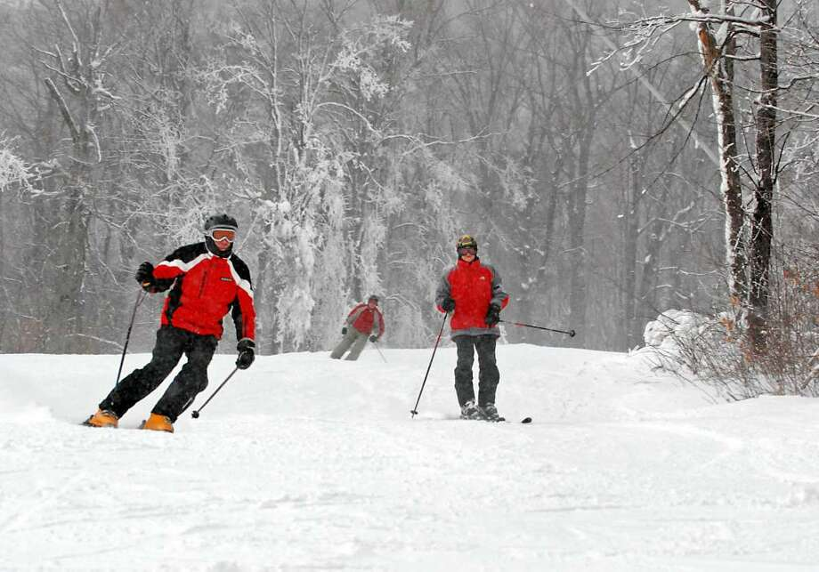 The good life is all downhill Friday as skiers enjoy the fresh snow at Gore Mountain in North Creek.  (Lori Van Buren / Times Union) Photo: LORI VAN BUREN