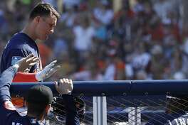 Houston Astros J.D. Davis (28) his congratulated by Bill Murphy after his solo home run in the fifth inning of the Houston Astros spring training game against the Nationals at The Fitteam Ballpark of the Palm Beaches, Friday, Feb. 23, 2018, in West Palm Beach.   ( Karen Warren / Houston Chronicle )