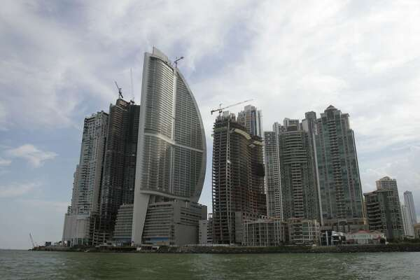 FILE - This July 4, 2011, file photo, shows the Trump International Hotel Panama , third building from left, in Panama City. One of President Donald Trump�s family businesses is battling an effort to physically evict its team of executives from the luxury hotel where they manage operations, and local police have been called repeatedly to keep peace, The Associated Press has learned. Representatives of the hotel owners� association formally sought to fire Trump�s management team Thursday, Feb. 22, 2018, by hand-delivering termination notices to them at the Trump International Hotel and Tower, according to a Panamanian legal complaint filed by Orestes Fintiklis, who controls 202 of the property�s 369 hotel units. (AP Photo/Arnulfo Franco, File)