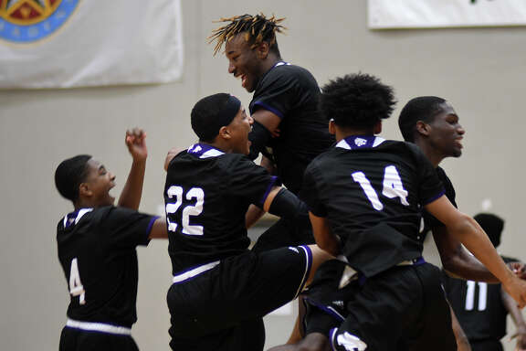 Humble junior forward Justin Lawson, center, celebrates with his teammates  after their Region III-5A Area Playoff win over Texas City at Phillips Fieldhouse in Pasadena on Feb. 23, 2018. (Photo by Jerry Baker/Freelance)
