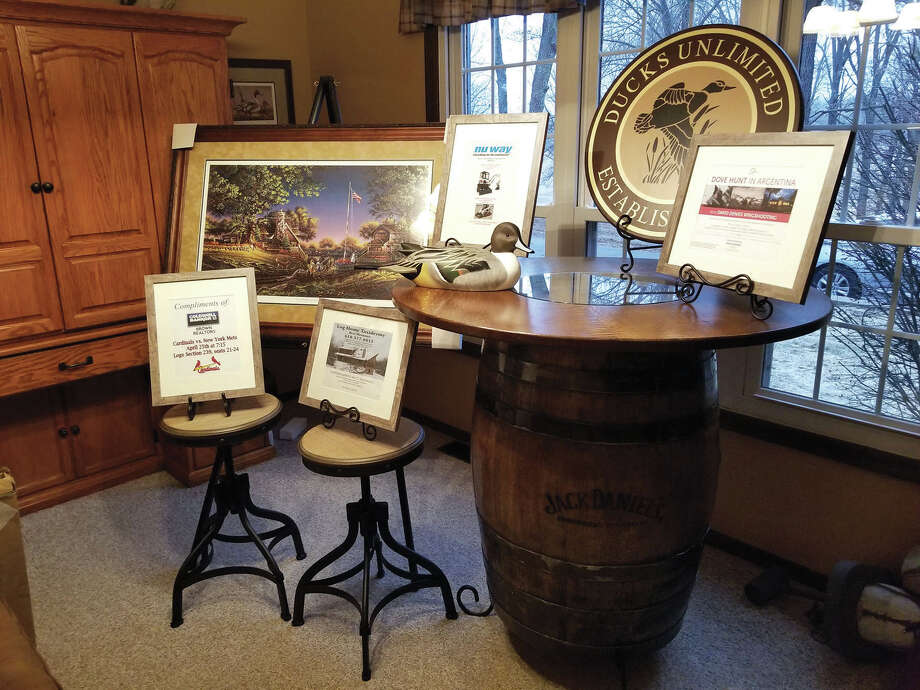 Pictured are some of the items that will be auctioned at the Ducks Unlimited Dinner, including the white oak tabletop that was made by Edwardsville's Bill Cerny. Photo: For The Intelligencer