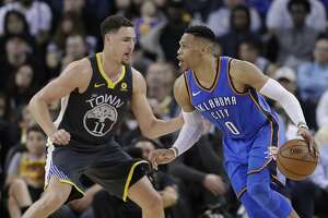 Oklahoma City Thunder's Russell Westbrook, right, is defended by Golden State Warriors' Klay Thompson during the second half of an NBA basketball game Tuesday, Feb. 6, 2018, in Oakland, Calif. (AP Photo/Marcio Jose Sanchez)