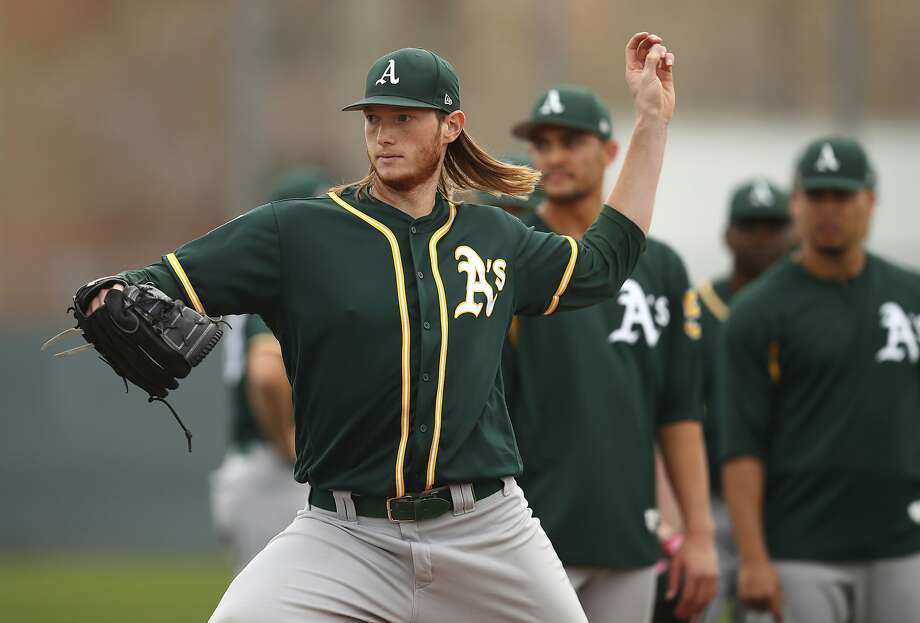 Oakland Athletics' A.J. Puk participates in a spring training baseball drill on Friday, Feb. 16, 2018 in Mesa, Ariz. (AP Photo/Ben Margot) Photo: Ben Margot, Associated Press