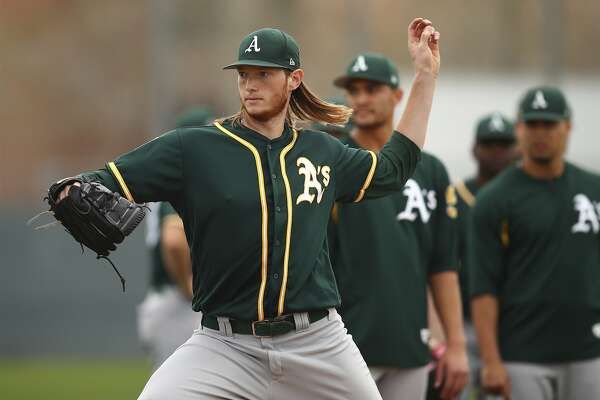 Oakland Athletics' A.J. Puk participates in a spring training baseball drill on Friday, Feb. 16, 2018 in Mesa, Ariz. (AP Photo/Ben Margot)