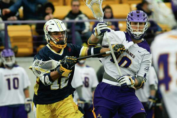 Drexel midfielder Cam Harris puts pressure on UAlbany defenseman Troy Reh during UAlbany's home opener on Saturday, Feb. 24, 2018, at Tom & Mary Casey Stadium in Albany, N.Y. (Jenn March, Special to the Times Union)