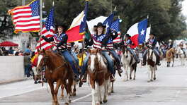 A color guard leads off the annual Houston Livestock Show and Rodeo Parade  on Saturday, Feb. 24, 2018, in Houston. (Brett Coomer / Houston Chronicle)