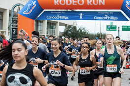 Runners take off from the start of Houston Livestock Show and Rodeo's Rodeo Run on Saturday, Feb. 24, 2018, in Houston. Proceeds from Rodeo Run presented by ConocoPhillips benefit the Houston Livestock Show and Rodeo? Educational Fund. ( Brett Coomer / Houston Chronicle )