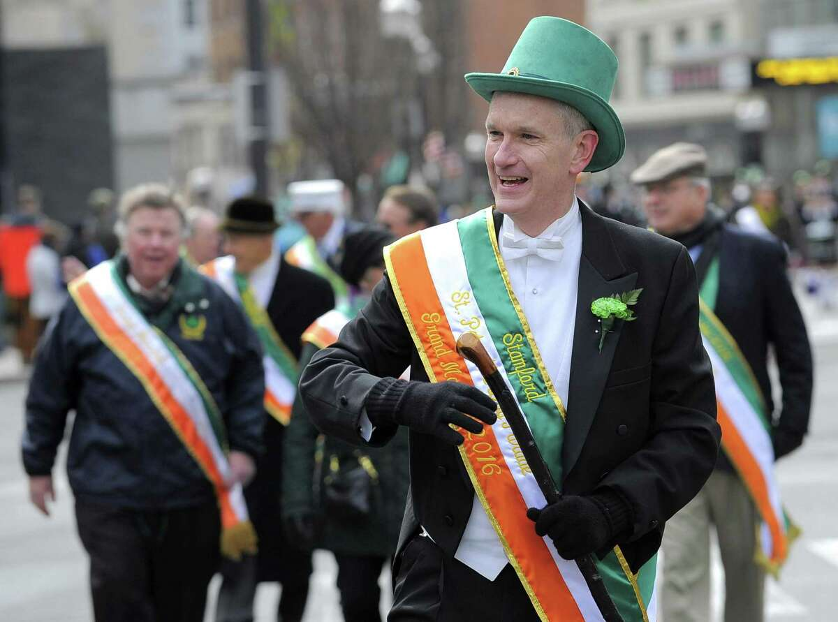 Connecticut Supreme Court Justice Andrew McDonald marches down Bedford Street during the annual St Patrick?'s Day parade in Stamford, Conn. on March 5, 2016. McDonald was the 2016 Grand Marshal for the event.